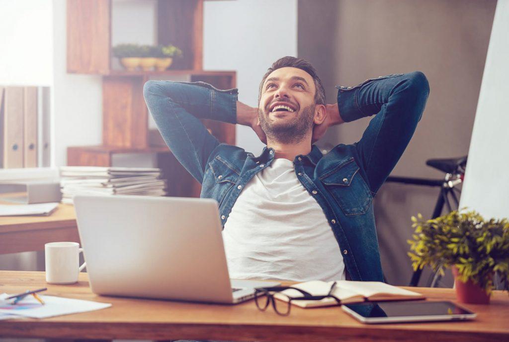 happy man on laptop